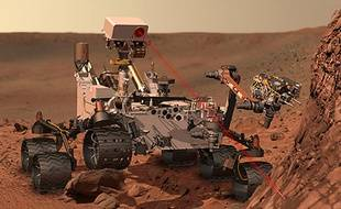 Vue d'artiste: Curiosity fore le sol martien.
