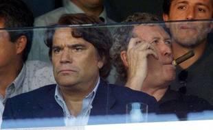 Le 8 septembre 2001, Bernard Tapie et Robert-Louis Dreyfus assistent à un match de l'OM au Vélodrome.