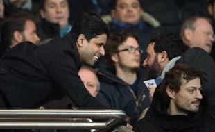Paris Saint-Germain's Qatari president Nasser Al-Khelaifi wand Cyril Hanouna attend the French L1 football match between PSG and Olympique Lyonnais at the Parc des Princes in Paris, FRANCE-13/12/2015.   /NIVIERE_0050NIV/Credit:NIVIERE/SIPA/1512140209