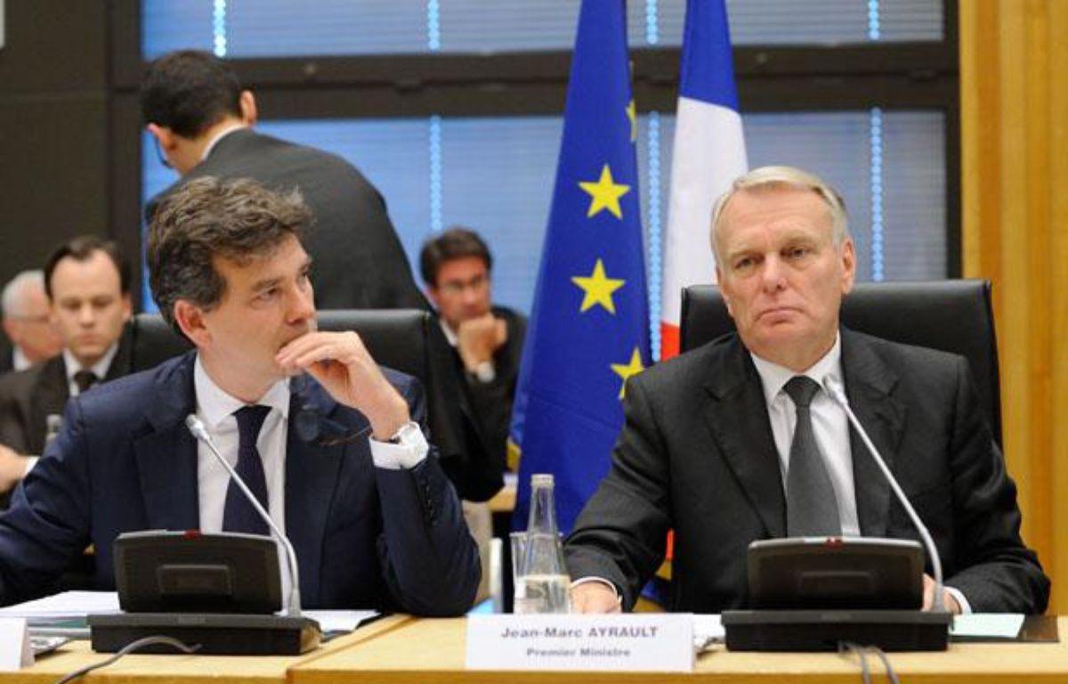 Arnaud Montebourg, ministre du Redressement productif, et Jean-Marc Ayrault, Premier ministre, lors de l'inauguration de la 20e Conférence nationale pour l'industrie – WITT/SIPA
