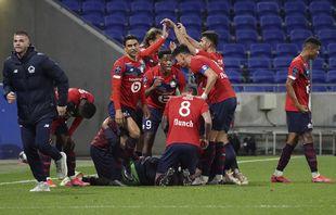 Célébrations des joueurs de Lille après le but inscrit par Burak Yilmaz contre Lyon, à Decines, le 25avril 2021.