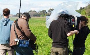 Une équipe de tournage (Illustration).