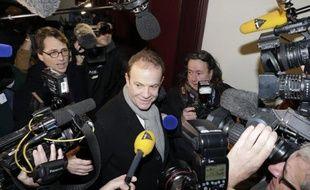 Le photographe François-Marie Banier (c) arrive le 26 janvier 2015 au Palais de justice de Bordeaux où commence le procès Bettencourt
