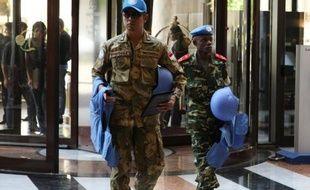 """Près de 40 personnes ont péri lundi dans les violences en Syrie, dont 22 soldats tués par des rebelles, le patron de l'ONU Ban Ki-moon parlant de """"moment critique"""" pour une solution pacifique en Syrie et réitérant sa crainte d'une guerre civile généralisée."""