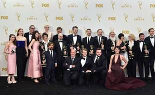 """The cast and crew of """"Game of Thrones"""", winners of the award for outstanding drama series, pose in the press room at the 67th Primetime Emmy Awards on Sunday, Sept. 20, 2015, at the Microsoft Theater in Los Angeles. (Photo by Jordan Strauss/Invision/AP)/CARA166/90056295592/092015112041/1509210707"""