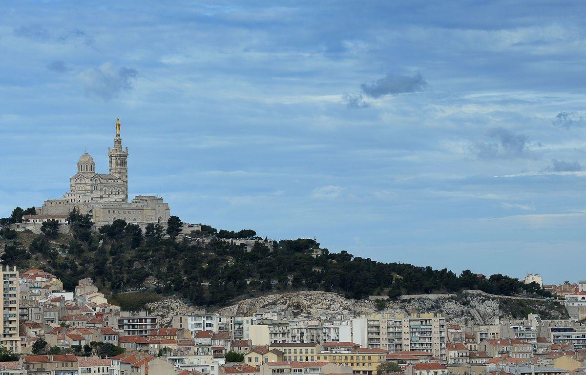 This photo taken on April 23, 2016 shows a view of the Notre-Dame de la Garde church in Marseille.  / AFP PHOTO / BORIS HORVAT – AFP