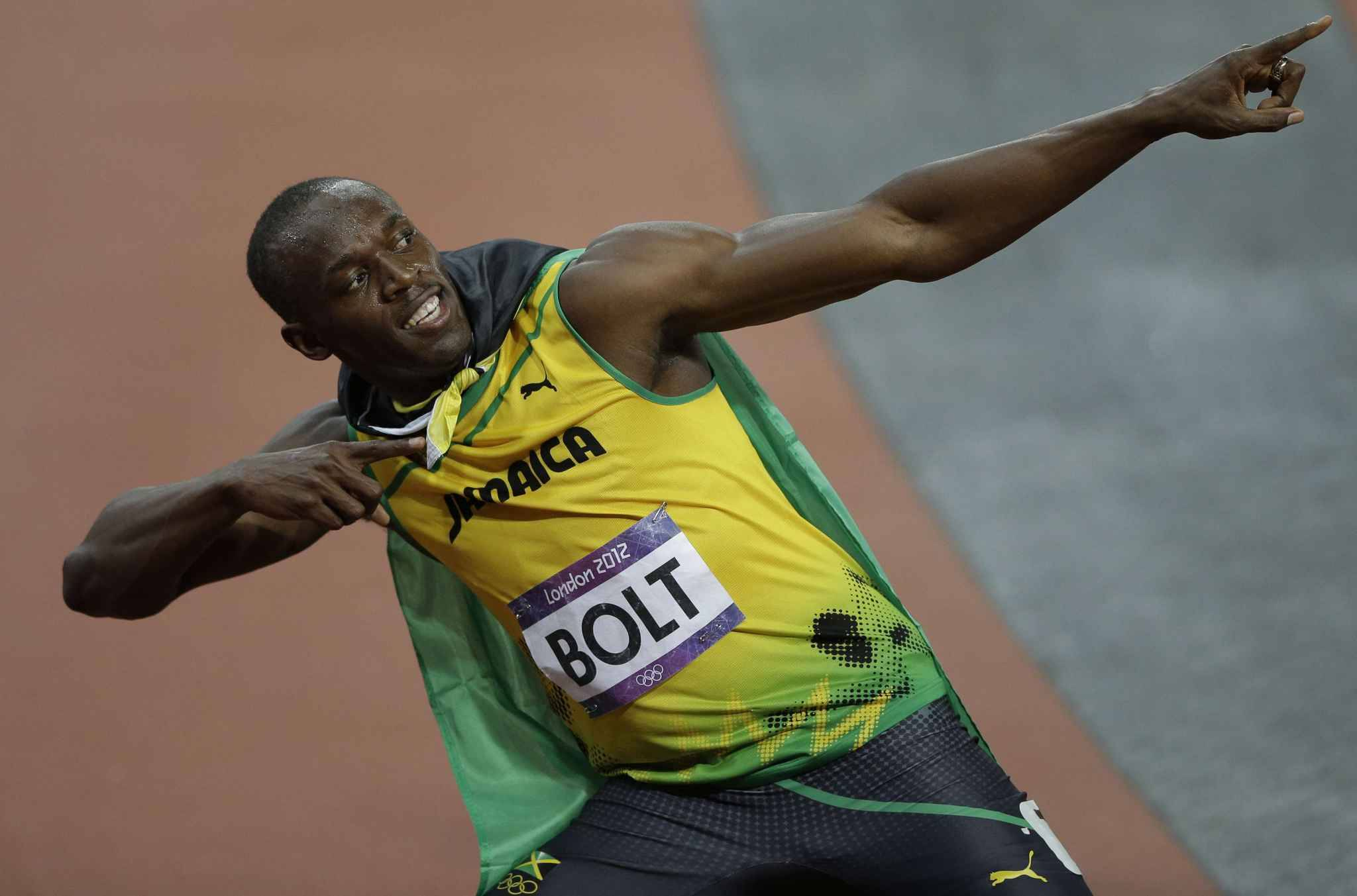 Jamaica's Usain Bolt reacts after winning the men's 100-meter during the athletics in the Olympic Stadium at the 2012 Summer Olympics, London, Sunday, Aug. 5, 2012.