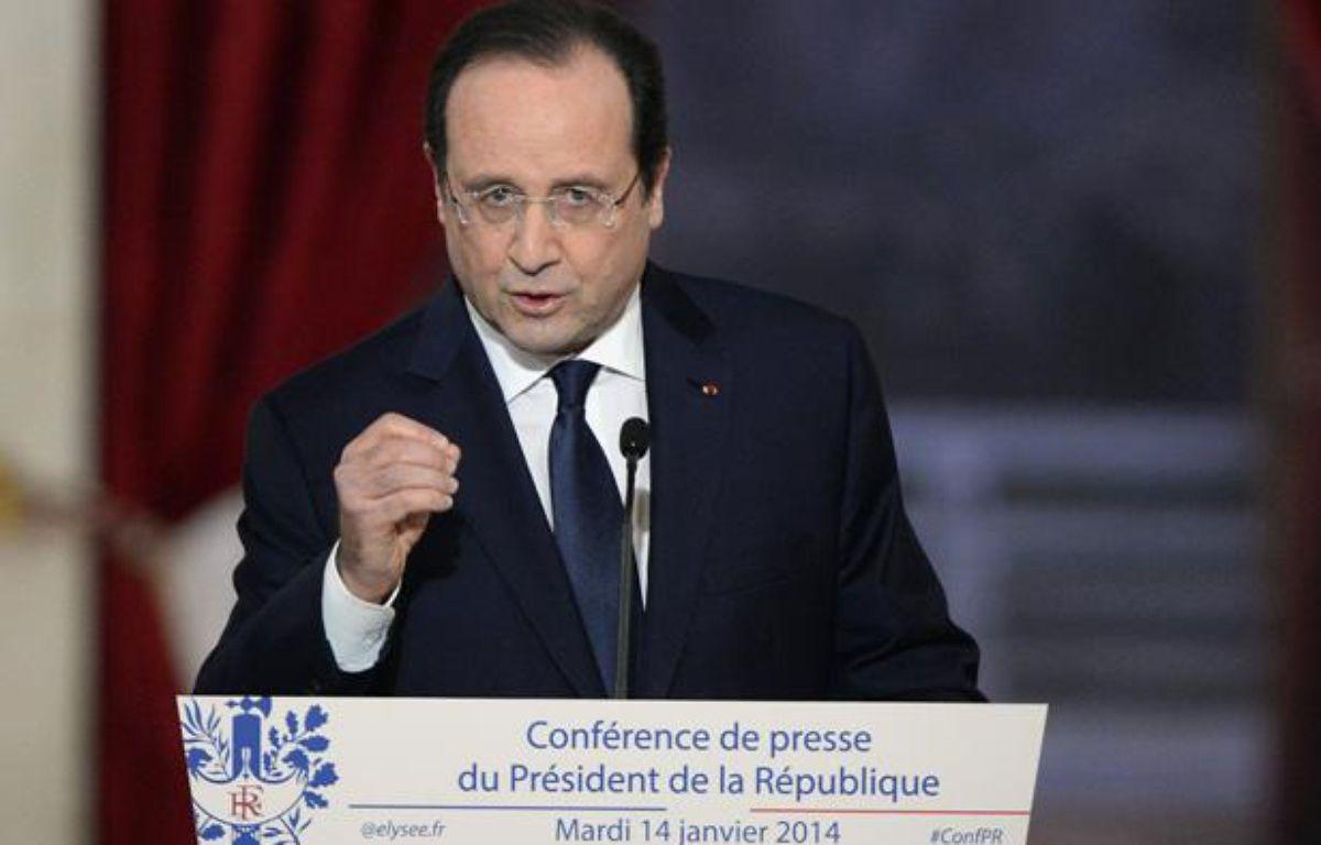 François Hollande lors de la conférence de presse donnée à l'Elysée le 14 janvier 2014. – ALAIN JOCARD / AFP