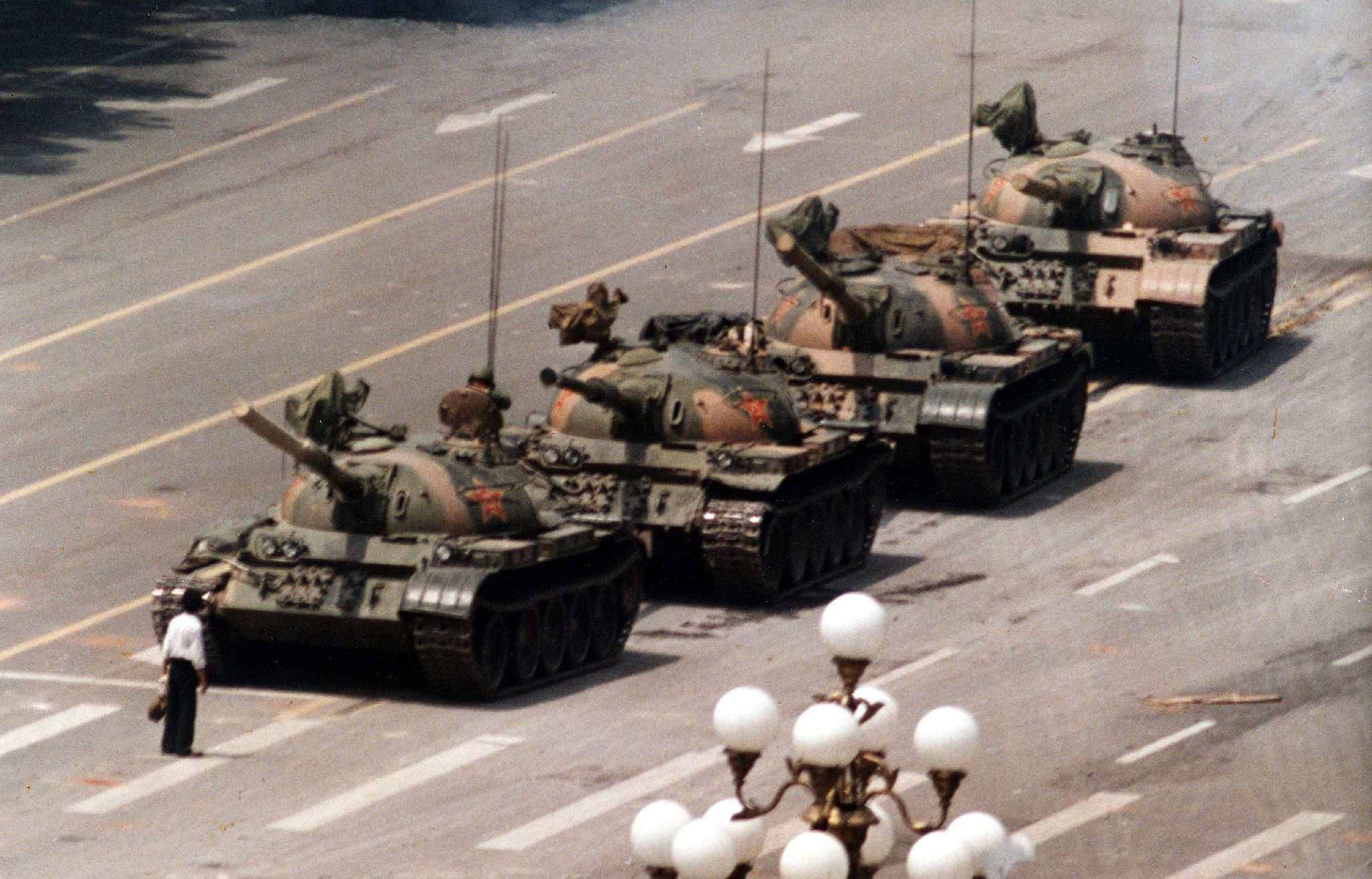FILE - In this June 5, 1989 file photo, a Chinese protestor blocks a line of tanks heading east on Beijing's Cangan Blvd. June 5, 1989 in front of the Beijing Hotel. The man, calling for an end to the violence and bloodshed against pro-democracy demonstrators, was pulled away by bystanders, and the tanks continued on their way. Thursday June 4, 2009 marks the 20th anniversary of the Chinese military assault on demonstrators on the night of June 3-4, 1989 in Tiananmen Square.