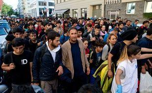 Des migrants arrivés à la gare de Munich, en Allemagne, le 12 septembre 2015.