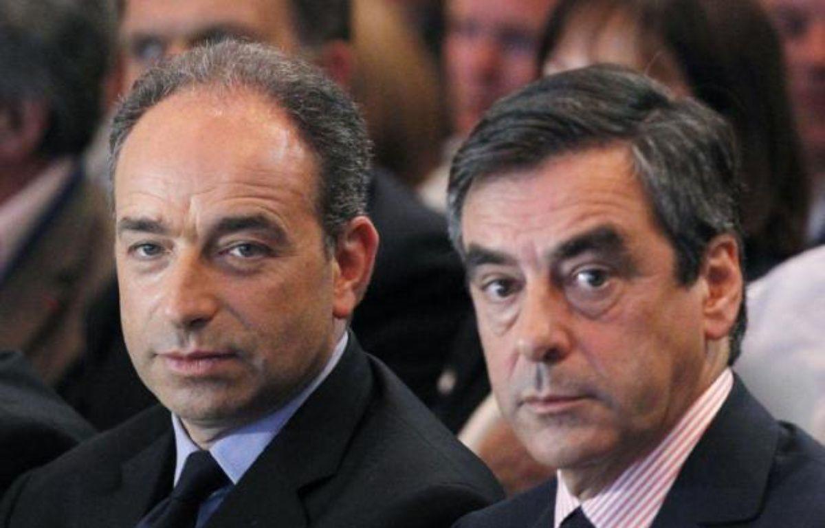 L'ancien Premier ministre François Fillon et le le secrétaire général de l'UMP, Jean-François Copé, s'en sont pris très vivement vendredi à Arnaud Montebourg pour avoir mis en cause la direction de PSA au sujet du plan de restructuration en cours. – Thomas Samson afp.com