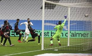 Nice's goalkeeper Walter Benitez, right, fails to save the ball as Marseille's Alvaro, center, scores his side's opening goal during the French League One soccer match between Olympique de Marseille and Nice at the Velodrome stadium in Marseille, southern France, Wednesday, Feb. 17, 2021. (AP Photo/Daniel Cole)/HAS113/21048732983170//2102172124