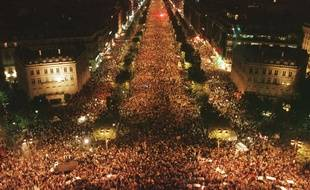 The view from the Arc de Triomphe looking along the Champs Elysees, in Paris in the early hours of Monday July 13 1998. Crowds gathered to celebrate the 3-0 victory of the French soccer team over Brazil in the final of the World Cup soccer championship played Sunday, July 12 1998 at the Stade de France, north of Paris.
