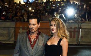Johnny Depp et Amber Head, en septembre 2015.