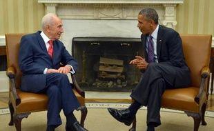 Le président israélien Shimon Peres (g) et son homologue américain Barack Obama à la Maison Blanche à Washington le 25 juin 2014