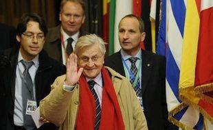 CORRECTION CREDIT IN CAPTION AND BYLINE La crise de la dette à laquelle l'Europe fait face n'a pas été surmontée en dépit des mesures engagées par les chefs d'Etat et de gouvernement de la zone euro, prévient le président de la Banque centrale européenne (BCE) Jean-Claude Trichet dans une interview