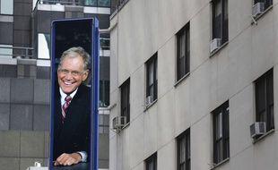 Les rues de New York où sont enregistrées les émissions de David Letterman affichaient la figure du mythique présentateur du Late Show , dont c'était la dernière mardi 20 mai 2015.