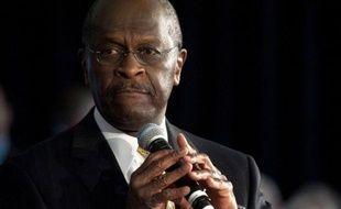 """Herman Cain annoncera """"avant lundi"""" s'il poursuit sa course à la primaire républicaine pour la présidentielle américaine de 2012 après une campagne perturbée par des accusations d'adultère et de harcèlement sexuel."""