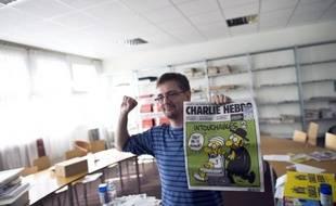 Un homme, soupçonné d'avoir appelé à décapiter le directeur de Charlie Hebdo sur un site jihadiste, a été interpellé samedi matin à La Rochelle, a-t-on appris de source judiciaire.