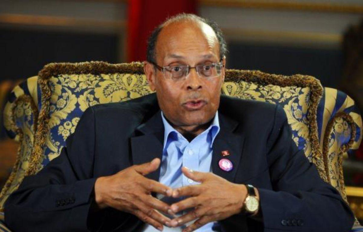 Le président tunisien Moncef Marzouki effectue à partir de mardi une visite en France à haute portée symbolique destinée à lever une bonne fois pour toutes le malentendu créé par le soutien de Paris à l'ancien régime du président Ben Ali jusqu'au lendemain de la révolution. – Fethi Belaid afp.com