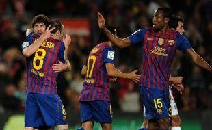 Le FC Barcelone s'est imposé 4-1 devant Malaga mercredi grâce notamment à trois buts de Lionel Messi et ne comptent plus que quatre points de retard sur le Real Madrid qui sera, malgré tout, sacré champion d'Espagne en cas de victoire sur le terrain de l'Athletic Bilbao.