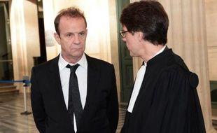 Banier et son avaocat Laurent Merlet au tribunal correctionnel de Bordeaux, le 2 février 2015