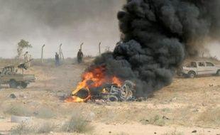 Image d'illustration. Les forces libyennes pro-gouvernement d'union nationale, le 2 juin 2016, en Libye, sur le site d'une attaque par des jihadistes à l'entrée de Syrte
