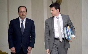 Francois Hollande et Manuel Valls à à l'issue du Conseil des ministres le 3 juin 2014 à l'Elysée à Paris