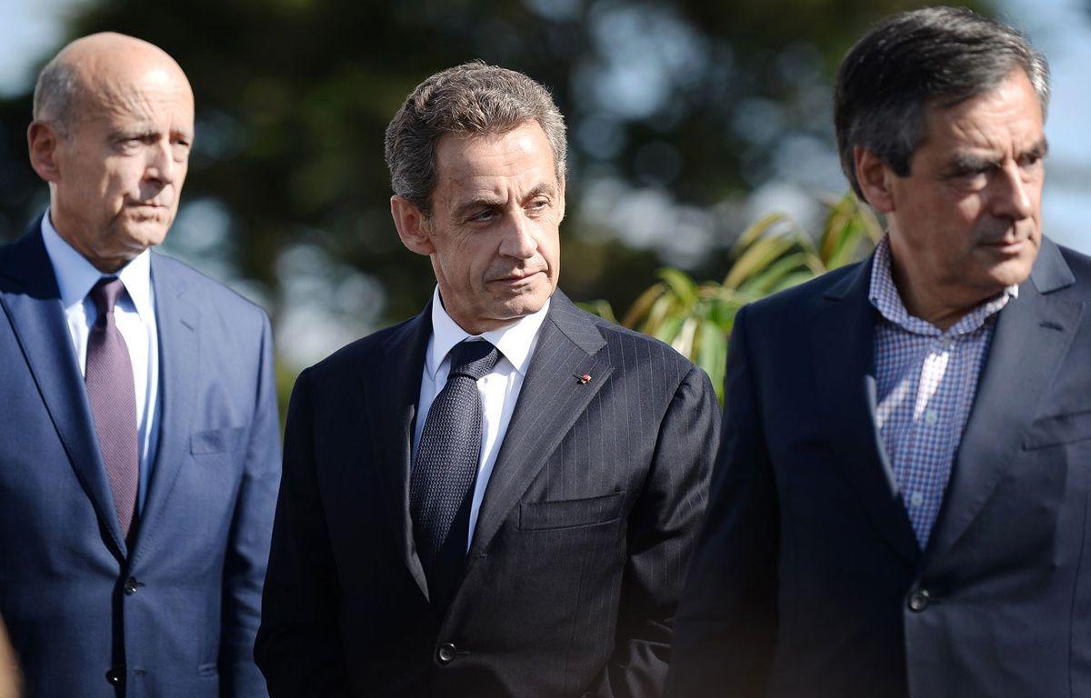 De gauche à droite, Alain Juppé, Nicolas Sarkozy et François Fillon à La Baule, le 5 septembre 2015. – JEAN-SEBASTIEN EVRARD/AFP