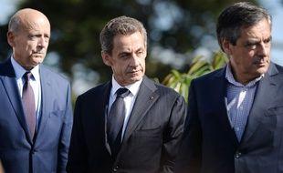 De gauche à droite, Alain Juppé, Nicolas Sarkozy et François Fillon à La Baule, le 5 septembre 2015.