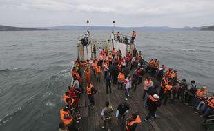 Les recherches se poursuivent après le naufrage d'un bateau sur le lac Toba en Indonésie, lundi 18 juin.