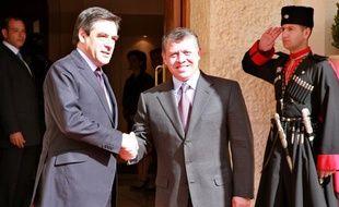 Le roi de Jordanie, Abdullah II, reçoit le Premier ministre français François Fillon au palais royal, à Amman, le 21 février 2010.