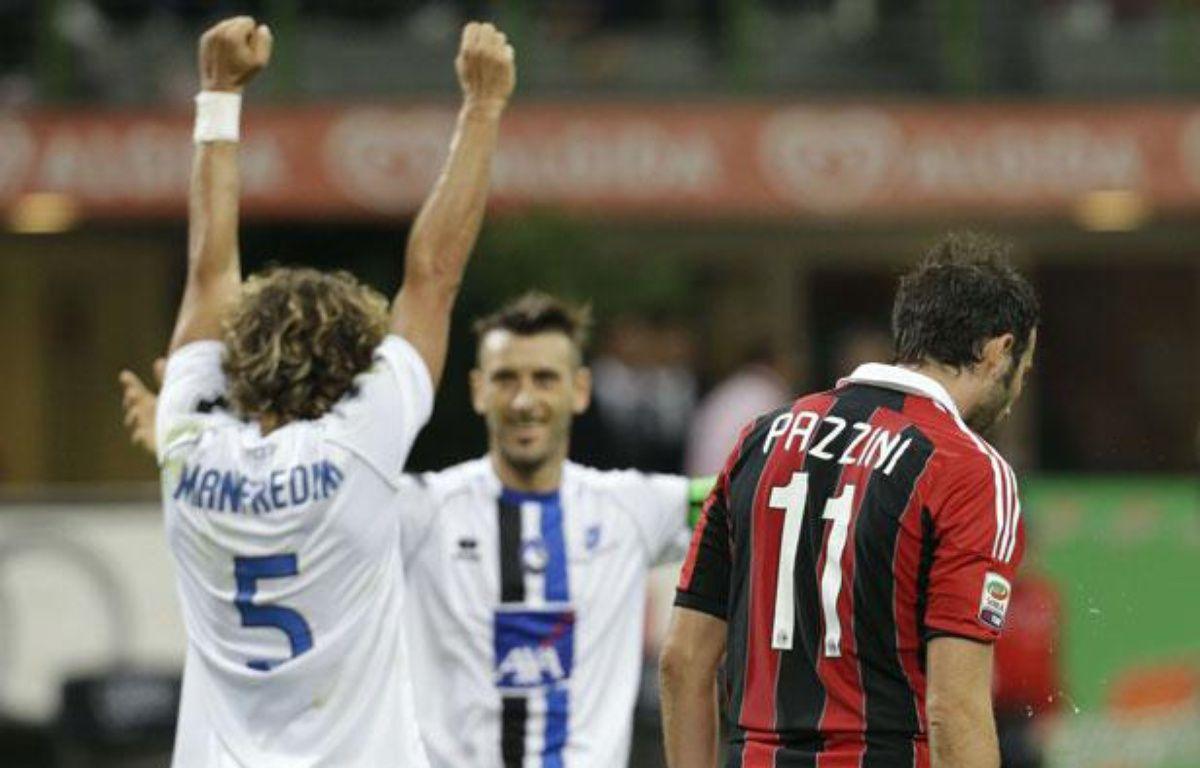 Les joueurs de l'Atalanta Bergame célèbrent leur victoire face à Milan, le 15 septembre 2012 – Luca Bruno/AP/SIPA