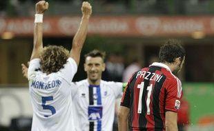 Les joueurs de l'Atalanta Bergame célèbrent leur victoire face à Milan, le 15 septembre 2012