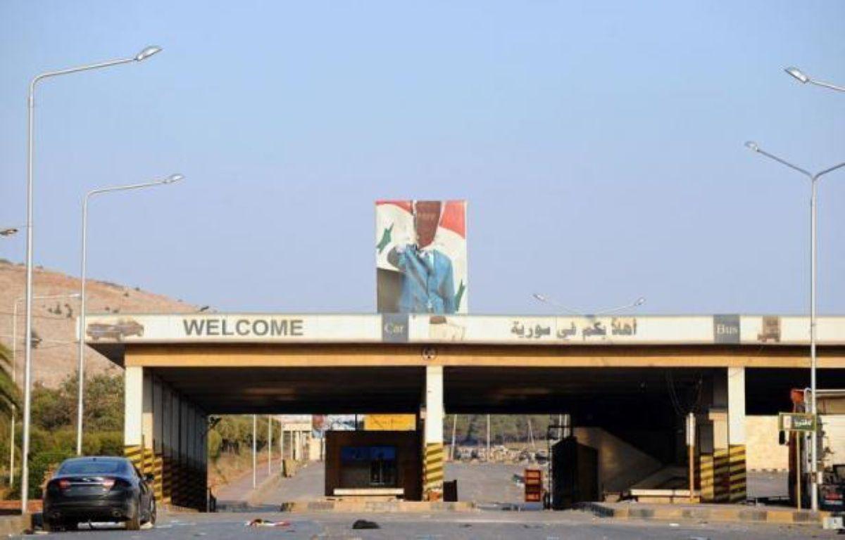 La rébellion syrienne contrôlait samedi plusieurs postes-frontières avec l'Irak et la Turquie, vitaux pour l'approvisionnement en armes, et affrontait l'armée à Alep, deuxième ville du pays et nouveau front de la contestation, tout en reculant à Damas. – Bulent Kilic afp.com