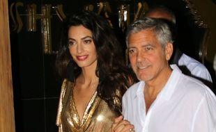 Amal Clooney  et George  Clooney à Ibiza (Espagne) le 23 août 2015.