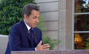 Nicolas Sarkozy répond en direct aux questions de David Pujadas sur France2, le 12 juillet 2010.