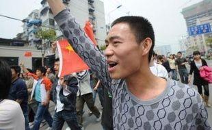 """Des manifestations pro-chinoises se sont déroulées samedi à Paris, Londres, Berlin et Vienne, pour dénoncer la """"désinformation"""" des médias occidentaux sur le Tibet et les appels au boycott des jeux Olympiques de Pékin."""