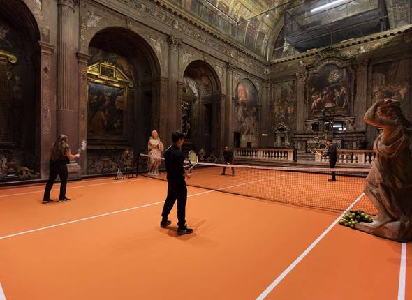 "An artist has transformed the floor of Milan's San Paolo Converso church into a fully functioning tennis court where anyone can play.  Created by New York based artist Asad Raza, the floor, net, rackets, tennis balls, iced tea, and coaches are all part of an interactive art piece named Untitled (Plot for Dialogue), which encourages visitors to play tennis in the beautiful church.  Raza's aim is to fill the space with a new social practice not of receiving messages from on high, but engaging in a two-way exchange and play of equals.  ""For Raza, the game serves as a method of absorbing energetic drives into symbolic but non-harmful practices,"" reads a description of the piece. ""Visitors become more than spectators - practicing with the coaches, the inhabit their bodies in coordinated action.""  Erected between 1549 and 1610, the church's frescos display the work of Giulio and Antonio Campi and depict the life of Paul the Apostle. The church was deconsecrated in 1808 following a decree issued by Napoleon and was used as a storage space until 1932, when it was renovated to become a concert hall. The space was also used as a recording studio between the 1960s and the 1980s.  The exhibition is running until 16 December and is free and open to the public from Thursday to Saturday. More information on Untitled (Plot for Dialogue) is available at the Converso website http://www.converso.online.  Where: Milan, Italy When: 16 Nov 2017 Credit: Asad Raza/San Paolo Converso/Cover Images  **EDITORIAL USE ONLY. IMAGES ONLY TO BE USED IN CONJUNCTION WITH EDITORIAL STORY. IMAGE COPYRIGHT REMAINS WITH THE PHOTOGRAPHER AND/OR SUPPLIER.**/COVER33326374/EDITORIAL USE ONLY. IMAGES ONLY TO BE USED IN CONJUNCTION WITH EDITORIAL STORY. IMAGE COPYRIGHT REMAINS WITH THE PHOTOGRAPHER AND/OR SUPPLIER./1711161842"