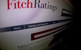 """L'agence de notation Fitch Ratings a abaissé la note de la France de """"AA+"""" à """"AA"""" en l'assortissant d'une perspective stable en raison notamment du dérapage budgétaire, le 12 décembre 2014"""