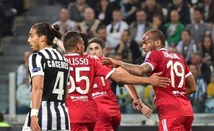 Les joueurs de l'OL ont cru l'exploit possible face à la Juventus après l'égalisation de Jimmy Briand (à d.)