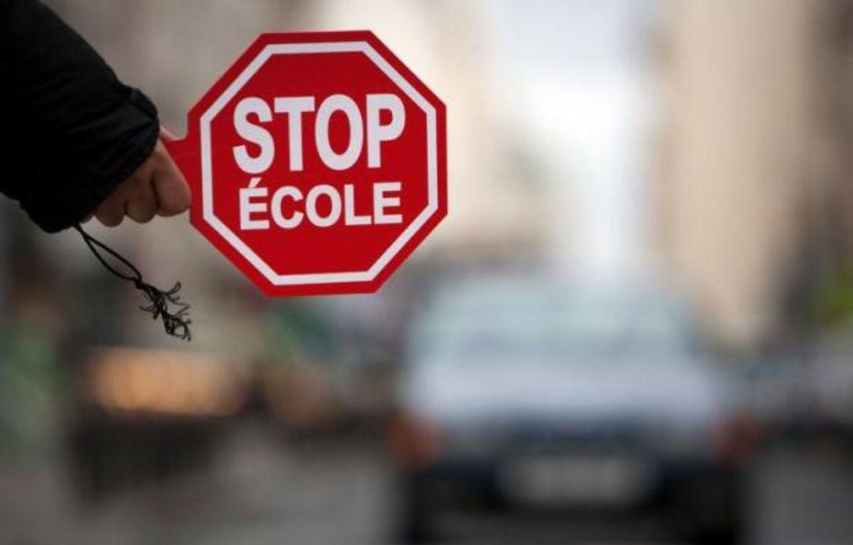 La Prévention Routière et Assureurs Prévention ont lancé jeudi une nouvelle opération nationale de sensibilisation afin d'apprendre aux enfants à maîtriser l'environnement de la rue et à se déplacer en toute sécurité sur le chemin de l'école. – Loic Venance afp.com