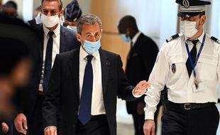 Nicolas Sarkozy à son arrivée au tribunal judiciaire de Paris, le 1er mars 2021.
