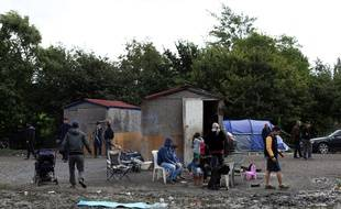 Une famille de Syriens dans le camp de Grande-Synthe en septembre 2015.