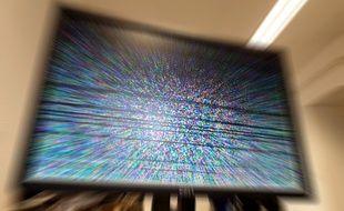 Parasites sur un écran de télévision (illustration).