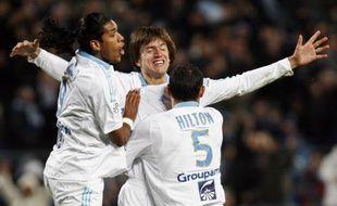Brandao, Civelli et Hilton célèbrent la victoire de Marseille face à nantes le 21 mars 2009. L'OM prend provisoirement la tête de la L1.