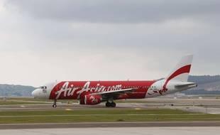 Un A320-200 de la Compagnie AirAsia sur le tarmac de l'aéroport de Sepang