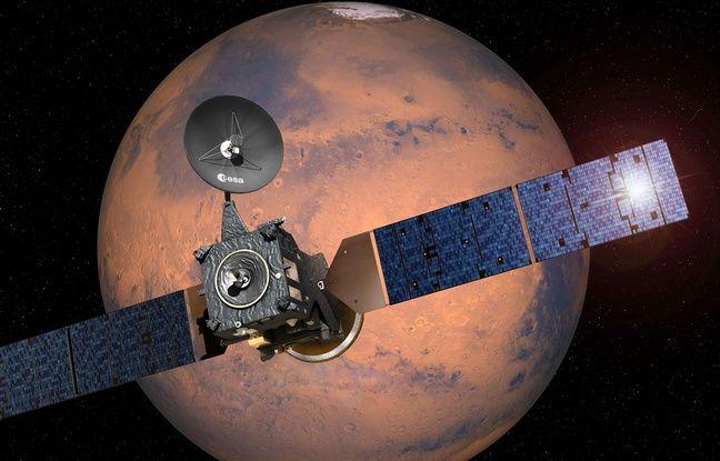 Représentation de la sonde Exomars en train de larguer son module d'atterrissage Schiaparelli sur la planète Mars.