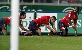 Les Lillois Gervinho (D), Rami (G) et Hazard (C), heureux lor de la victoire du LOsc face à Montpellier (4-1) à Villeneuve d'Ascq, le 28 mars 2010.
