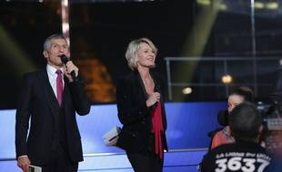 Nagui et Sophie Davant lors du Téléthon 2014.